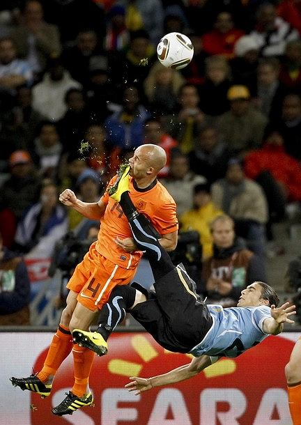 Mike Hutchings, a Reuters photographer based in South Africa, has won the 1st Prize Sport Single category with this picture of Netherlands' Demy de Zeeuw being kicked in the face by Uruguay's Martin Caceres during their World Cup semi-final in Cape Town, taken July 6. The prize-winning entries of the World Press Photo Contest 2010, the world's largest annual press photography contest, were announced February 11, 2011. REUTERS/Mike Hutchings (SOUTH AFRICA - Tags: MEDIA SOCIETY SPORT SOCCER IMAGES OF THE DAY)