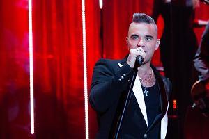 """Robbie Williams przyjechał do Polski w ramach promocji swojej pierwszej świątecznej płyty """"The Christmas Present"""". TVP2 pokaże świąteczną galę Robbiego Williamsa w pierwszy dzień Świąt o 20:10."""