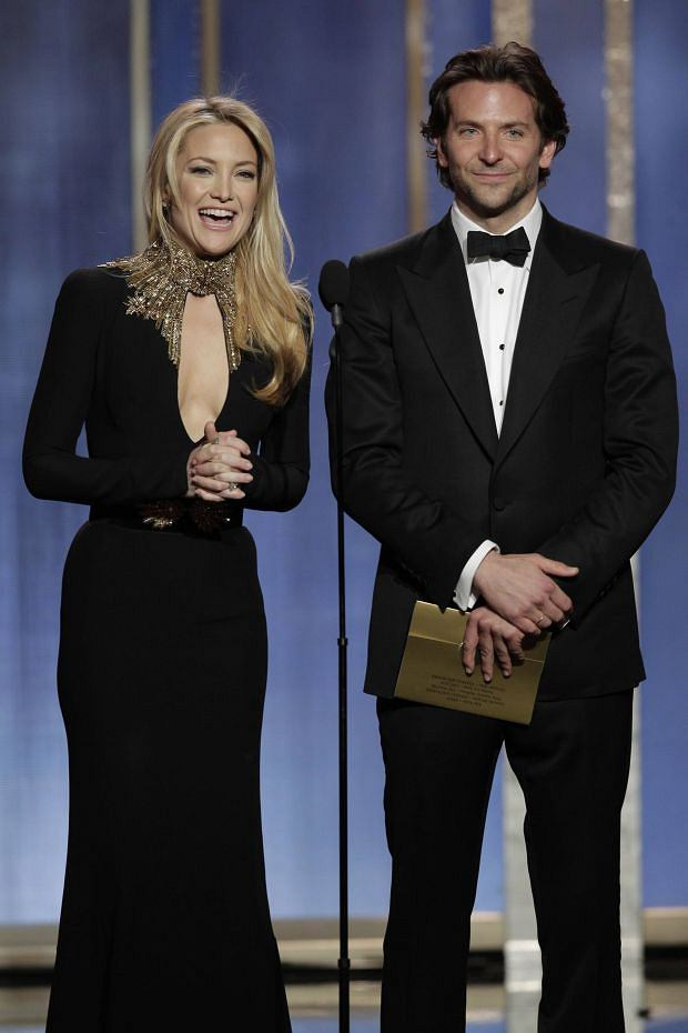 Kate Hudson (L) and Bradley Cooper present on stage at the 70th annual Golden Globe Awards in Beverly Hills, California January 13, 2013, in this picture provided by NBC. REUTERS/Paul Drinkwater/NBC/Handout  (UNITED STATES - Tags: ENTERTAINMENT) (GOLDENGLOBES-SHOW)   ATTENTION EDITORS - THIS IMAGE WAS PROVIDED BY A THIRD PARTY. FOR  EDITORIAL USE ONLY. NOT FOR SALE FOR MARKETING OR ADVERTISING CAMPAIGNS. THIS PICTURE IS DISTRIBUTED EXACTLY AS RECEIVED BY REUTERS, AS A SERVICE TO CLIENTS. NO SALES. NO ARCHIVES