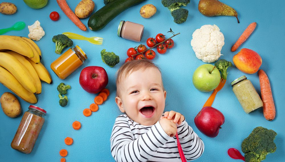 https://www.shutterstock.com/pl/image-photo/baby-surrounded-fruits-vegetables-on-blue-573819535