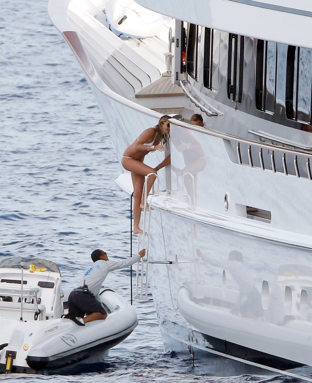 July 14th 2015 - Saint Tropez  Exclusive Picture  Elle Macpherson The Body shows off her incredible body on a tiny sexy white bikini while trying to escape the paparazzi stationed at the back of the yacht after a morning swim, Elle returned to the boat by climbing an other access of her superyacht.  BYLINE MUST READ :  Spread Pictures   No Web Usage before agreement  Please hide the childrens faces prior to the publication  Stricly No Mobile Phone Application or Apps use without our Prior Agreement  Enquiries at photospreadpictures.com
