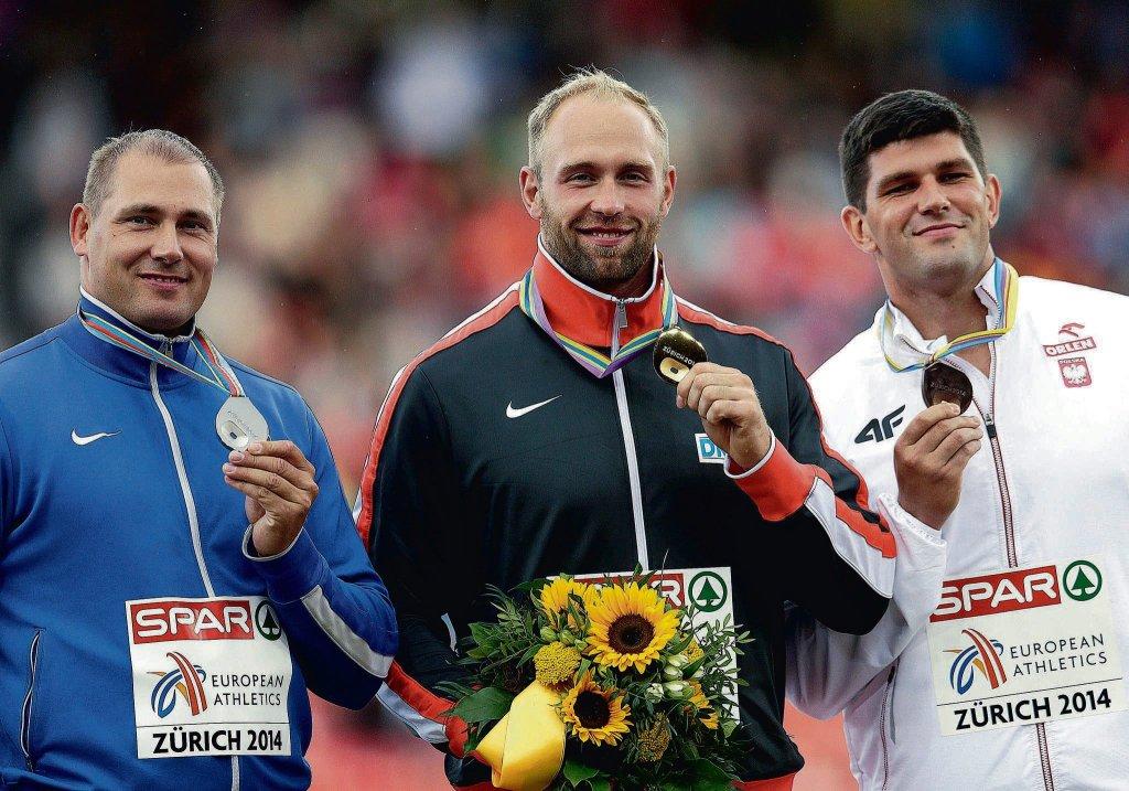 Od lewej Gerd Kanter (Estonia), Robert Harting (Niemcy) i Robert Urbanek