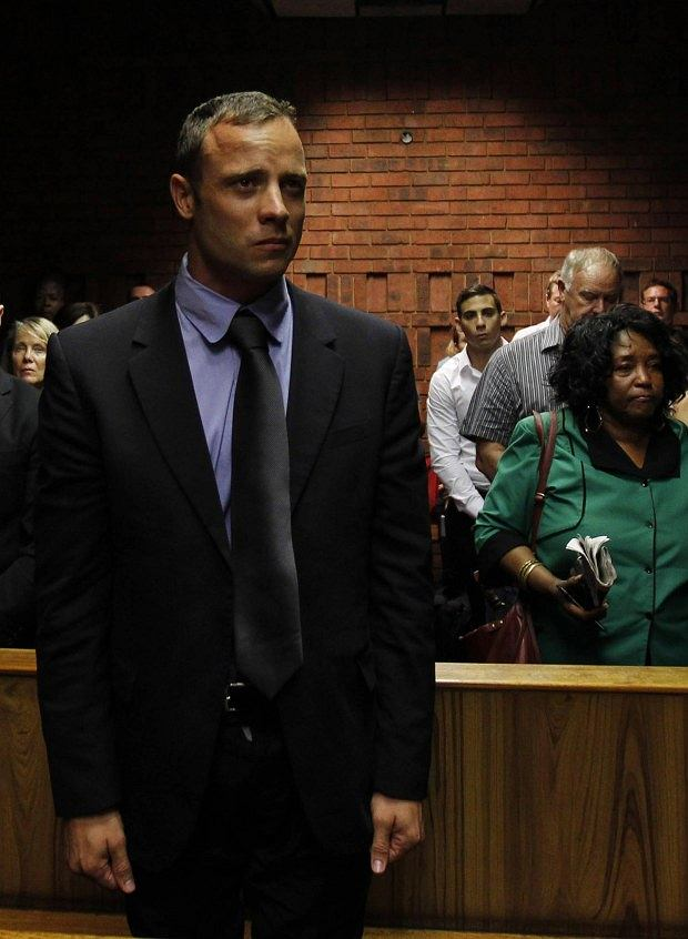 """Blade Runner"" Oscar Pistorius awaits the start of court proceedings in the Pretoria Magistrates court February 19, 2013. Pistorius, a double amputee who became one of the biggest names in world athletics, was applying for bail after being charged in court with shooting dead his girlfriend, 30-year-old model Reeva Steenkamp, in his Pretoria house.  REUTERS/Siphiwe Sibeko (SOUTH AFRICA - Tags: CRIME LAW SPORT ATHLETICS)"