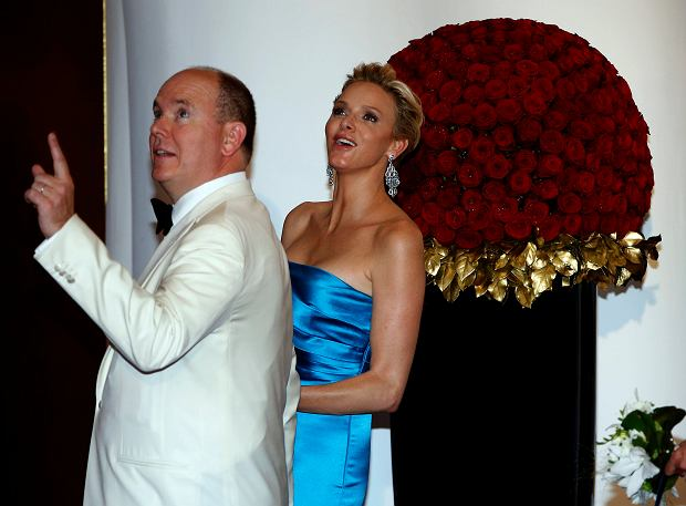 Prince Albert II of Monaco and his wife Princess Charlene arrive to attend the Red Cross Gala in Monte Carlo August 2, 2013. The Red Cross Gala is a traditional and annual charity event in the Principality of Monaco. REUTERS/Eric Gaillard (MONACO - Tags: ENTERTAINMENT ROYALS)