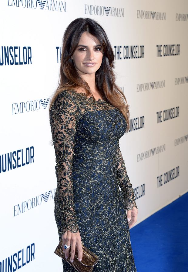 Spanish actress Penelope Cruz poses for photographers as she arrives for the UK Premiere of ?The Counselor?, on Thursday Oct. 3, 2013, in London. (Photo by Jon Furniss/Invision/AP Images)