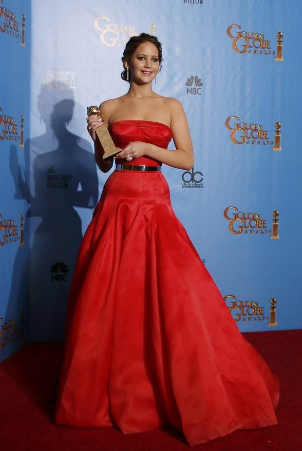 "REFILE - CORRECTING ID OF HOLLYWOOD FOREIGN PRESS ASSOCIATION MEMBER    Jennifer Lawrence holds the award she won for Best Actress in a Motion Picture, Comedy or Musical for her work in ""Silver Linings Playbook"" as Yoram Kahana, of the Hollywood Foreign Press Association, looks on backstage at the 70th annual Golden Globe Awards in Beverly Hills, California, January 13, 2013.  REUTERS/Lucy Nicholson (UNITED STATES  - Tags: ENTERTAINMENT)  (GOLDENGLOBES-BACKSTAGE)"