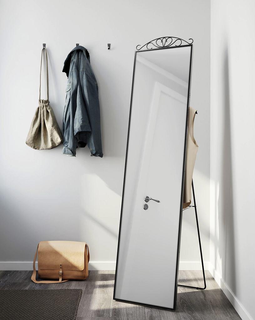 Ozdobne lustro stojące w metalowej ramie