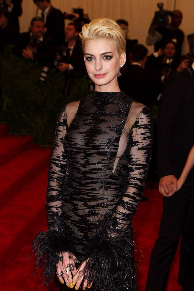 """Actress Anne Hathaway arrives at the Metropolitan Museum of Art Costume Institute Benefit celebrating the opening of """"PUNK: Chaos to Couture"""" in New York, May 6, 2013. REUTERS/Lucas Jackson (UNITED STATES - Tags: ENTERTAINMENT FASHION)"""
