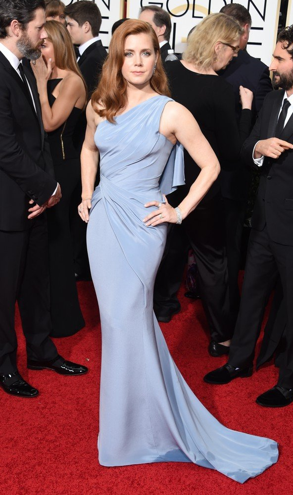 Actress Amy Adams arrives on the red carpet for the 72nd Annual Golden Globe Awards, January 11, 2015 at the Beverly Hilton Hotel in Beverly Hills, California. AFP PHOTO / MARK RALSTON