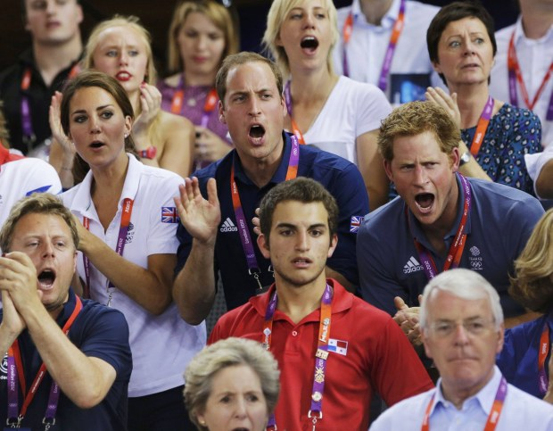 Britain's Prince William (C), his wife Catherine (L), Duchess of Cambridge and Prince Harry cheer for the British team as they watch the track cycling event at the Velodrome during the London 2012 Olympic Games August 2, 2012. REUTERS/Cathal McNaughton (BRITAIN  - Tags: OLYMPICS SPORT CYCLING ROYALS TPX IMAGES OF THE DAY)