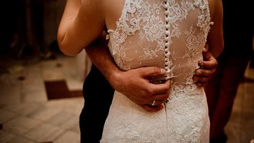 :A,Midsection,Of,A,Wedding,Couple,Slow,Dancing,With,Grooms