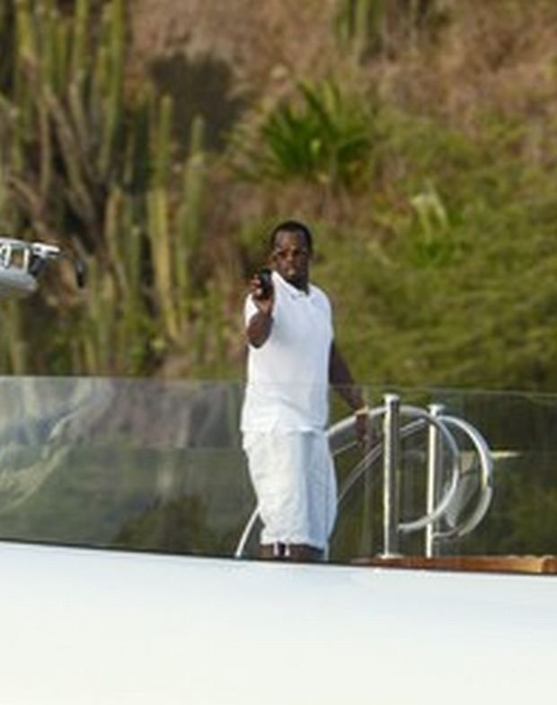 P Diddy is seen taking video and pics of himself with the view of St Barths in the background as his yacht comes into port to dock after an afternoon at sea. P Diddy is seen talking to his phone and turning the direction of the phone to face him while he shows the yacht entering the port of St Barths.  Pictured: P Diddy