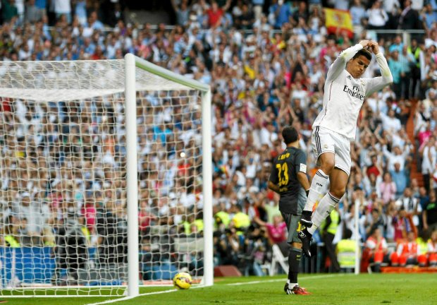 Real Madrid's Cristiano Ronaldo celebrates after scoring against Barcelona during their Spanish first division