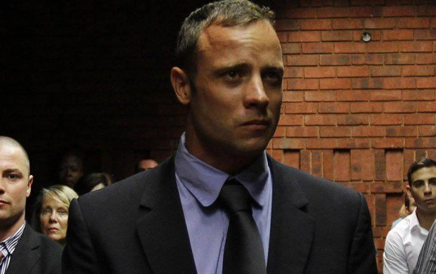 """Blade Runner"" Oscar Pistorius awaits the start of court proceedings in the Pretoria Magistrates court February 19, 2013. Pistorius, a double amputee who became one of the biggest names in world athletics, was applying for bail after being charged in court with shooting dead his girlfriend, 30-year-old model Reeva Steenkamp, in his Pretoria house.  REUTERS/Siphiwe Sibeko (SOUTH AFRICA - Tags: CRIME LAW SPORT ATHLETICS TPX IMAGES OF THE DAY)"