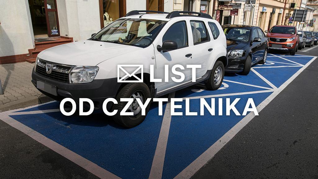 Miejsce parkingowe zarezerwowane dla osób niepełnosprawnych.