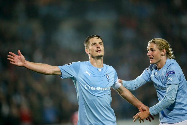 Malmos double scorer Markus Rosenberg celebrates with teammate Pawel Cibicki (R) after his game-winning second goal during their Champions League Group A soccer match against Olympiakos Piraeus, in Malmo October 1, 2014. Rosenbergs double sparked jubilant scenes at the Swedbank Stadium as Malmo beat Olympiakos Piraeus 2-0 in the first Champions League group stage match to be played on Swedish soil in 14 years. REUTERS/Andreas Hillergren/TT News Agency (SWEDEN - Tags: SPORT SOCCER) ATTENTION EDITORS - THIS IMAGE HAS BEEN SUPPLIED BY A THIRD PARTY. FOR EDITORIAL USE ONLY. NOT FOR SALE FOR MARKETING OR ADVERTISING CAMPAIGNS. THIS PICTURE IS DISTRIBUTED EXACTLY AS RECEIVED BY REUTERS, AS A SERVICE TO CLIENTS. SWEDEN OUT. NO COMMERCIAL OR EDITORIAL SALES IN SWEDEN. NO COMMERCIAL SALES