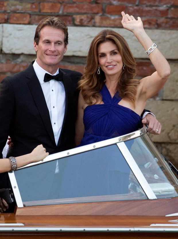 Cindy Crawford, right,  and Rande Gerber  leave the Cipriani hotel to go to the George Clooneys wedding with Amal Alamuddin, in Venice, Italy, Saturday, Sept. 27, 2014. (AP Photo/Andrew Medichini)