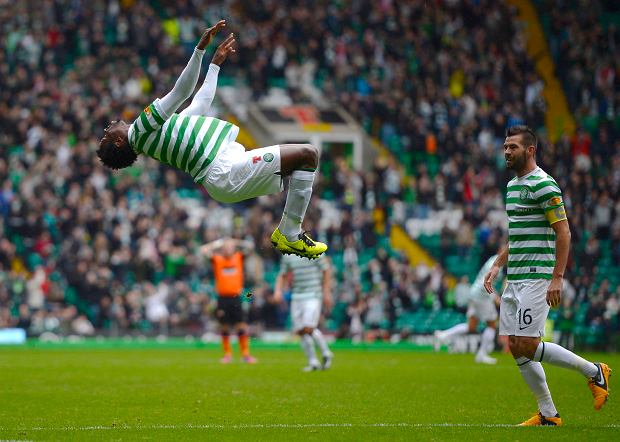 Celtic's Efe Ambrose celebrates his goal against Dundee United during their Scottish Premier League soccer match at Celtic Park Stadium in Glasgow, Scotland February 16, 2013. REUTERS/Russell Cheyne (BRITAIN - Tags: SPORT SOCCER)