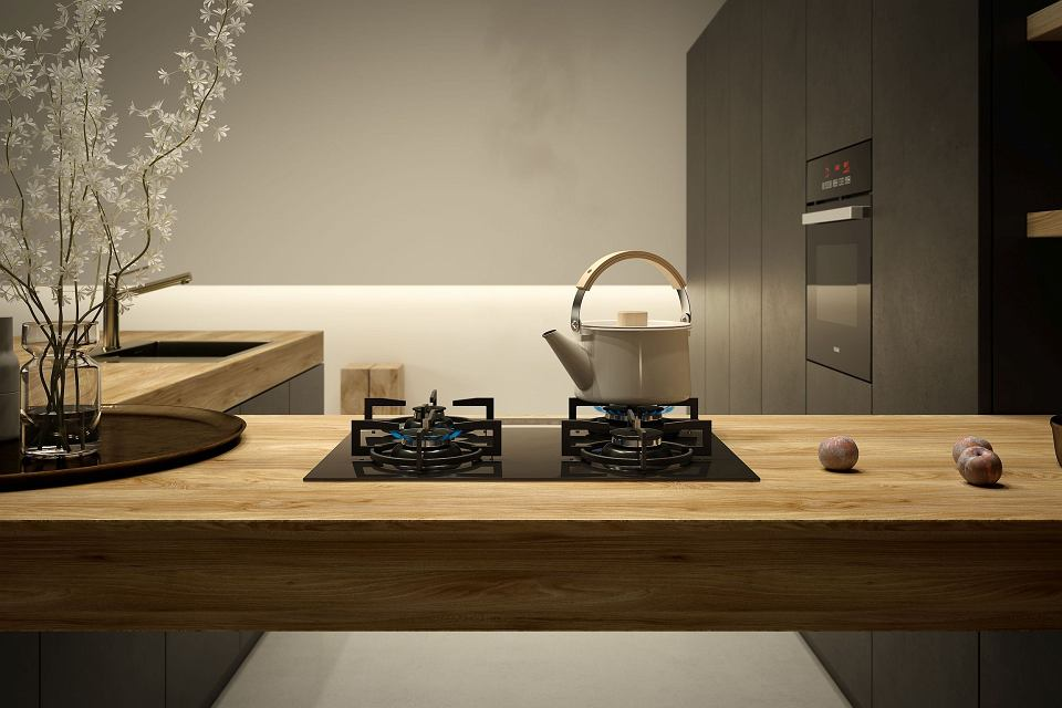 Kuchnia 2021 roku z czarnym piekarnikiem i płytą gazową.