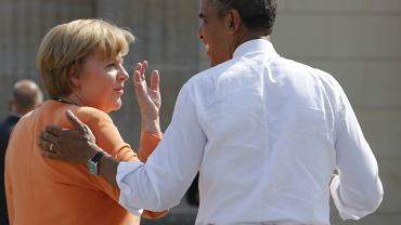 kFile photo of U.S. President Obama chatting with German Chancellor Merkel at the Brandenburg Gate in Berlin