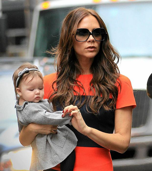 Victoria Beckham out and about with Harper Seven in NYC.  Pictured: Victoria Beckham and Harper Seven BeckhamSLOWA KLUCZOWE:out and about holding hands holding baby carrying baby stars and their children stars with their children parent and child family obligations adorable baby cute baby baby out with baby Harper Beckham Harper Seven Beckham sunglasses Victoria Beckham Posh Spice brunette hair dark hair long hair wavy hair