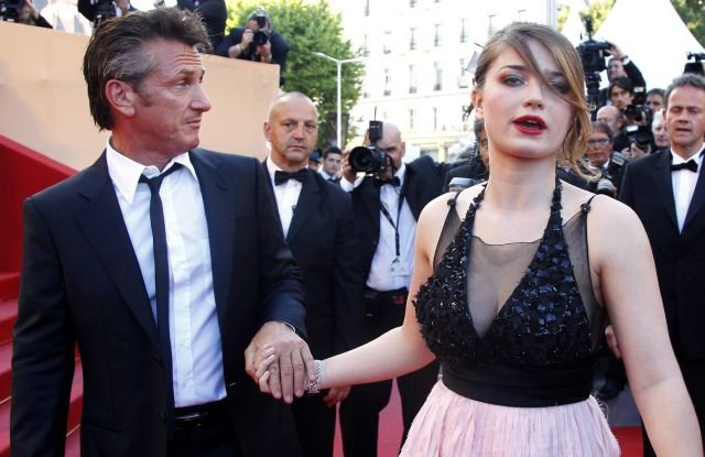Actors Sean Penn, left, and Eve Hewson arrive for the screening of This Must be the Place at the 64th international film festival, in Cannes, southern France, Friday, May 20, 2011. (AP Photo/Francois Mori)