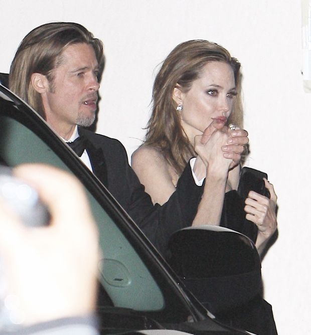 Brad Pitt and Angelina Jolie at Craig's Restaurant for George Clooney's Oscars after party. Febuary 26, 2012. X17online.com *** Local Caption ***  Brad Pitt and Angelina Jolie