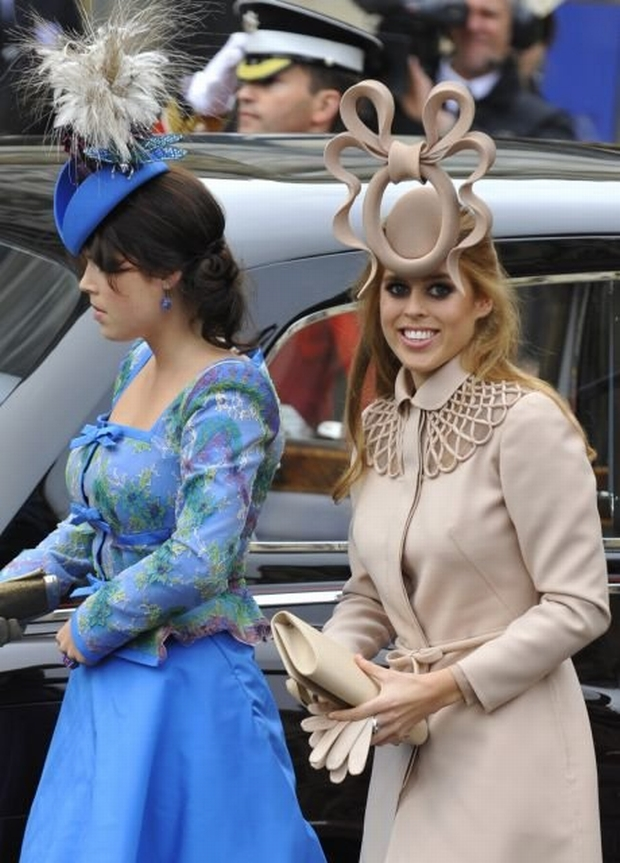Princess Beatrice (R) and her sister Princess Eugenie arrive at Westminster Abbey before the wedding of Britain's Prince William and Kate Middleton in central London April 29, 2011. (ROYAL WEDDING/VIP)          REUTERS/Toby Melville (BRITAIN  - Tags: ROYALS SOCIETY ENTERTAINMENT)
