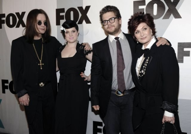 "From left to right, Ozzy Osbourne, Kelly Osbourne, Jack Osbourne and Sharon Osbourne, cast members in the show ""Osbournes: Reloaded,"" arrive at the FOX Winter All-Star Party in Los Angeles, Tuesday, Jan. 13, 2009. (AP Photo/Chris Pizzello)"