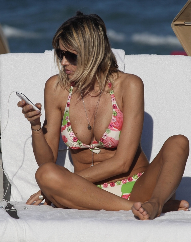 MAVRIXONLINE.COM - DAILY MAIL ONLINE OUT - Croatian actress Rita Rusic was seen, just a few days before Christmas, enjoying her holiday vacation on the beach with her much younger boyfriend. The busty 51 year old film producer and former wife of contractor Vittorio Cechi Gori appeared to enjoy soaking up the sun in a multi-colored skimpy bikini. Rusic was seen snuggling up to her boyfriend while looking at his cellphone and appeared to enjoy his company. Miami, FL. 22nd December 2011.  Fees must be agreed for image use.  Byline, credit, TV usage, web usage or linkback must read MAVRIXONLINE.COM.  Failure to byline correctly will incur double the agreed fee.  Tel: +1 305 542 9275.