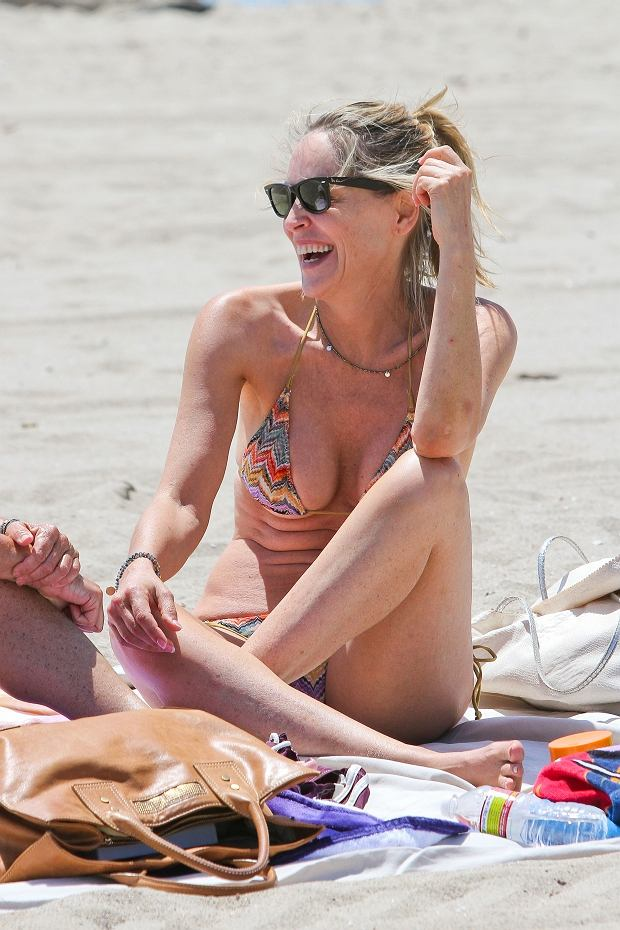 [NO Brazil] *EXCLUSIVE* Venice, CA - Actress Sharon Stone takes advantage of a beautiful sunny day and heads to the beach to catch some rays with her assistant.  Sharon and her girlfriend stopped to chat with a tarot card reader and see what lies in the future for them.    AKM-GSI          May 16, 2012    [NO Brazil]    To License These Photos, Please Contact :    Steve Ginsburg  (310) 505-8447  (323) 423-9397  steve@ginsburgspalyinc.com  sales@ginsburgspalyinc.com    or    Keith Stockwell  (310) 261-8649  (323) 325-8055   keith@ginsburgspalyinc.com  ginsburgspalyinc@gmail.com    or    Thaissa Kantif Voigt  (310) 619-0000  thaissa.voigt@akmimages.net       *** Local Caption ***  Sharon Stone