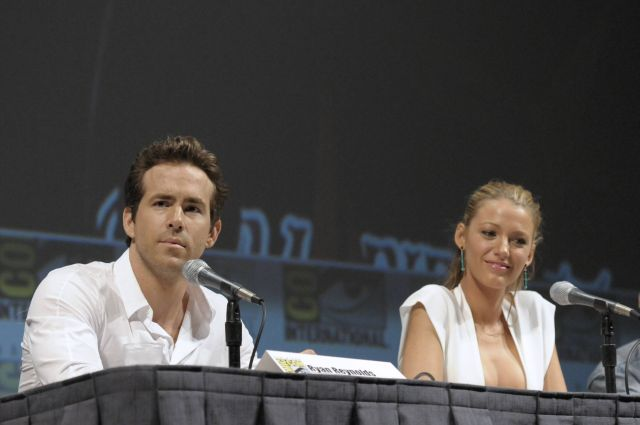 """Actor Ryan Reynolds, left, and actress Blake Lively speak at a panel discussion of their feature film """"Green Lantern"""" at Comic Con in San Diego, Calif. on Saturday, July 24, 2010. (AP Photo/Dan Steinberg)"""