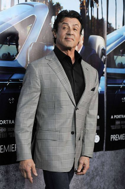 """Sylvester Stallone arrives at the premiere of the HBO documentary film """"His Way"""" in Los Angeles, Tuesday, March 22, 2011. (AP Photo/Chris Pizzello)"""