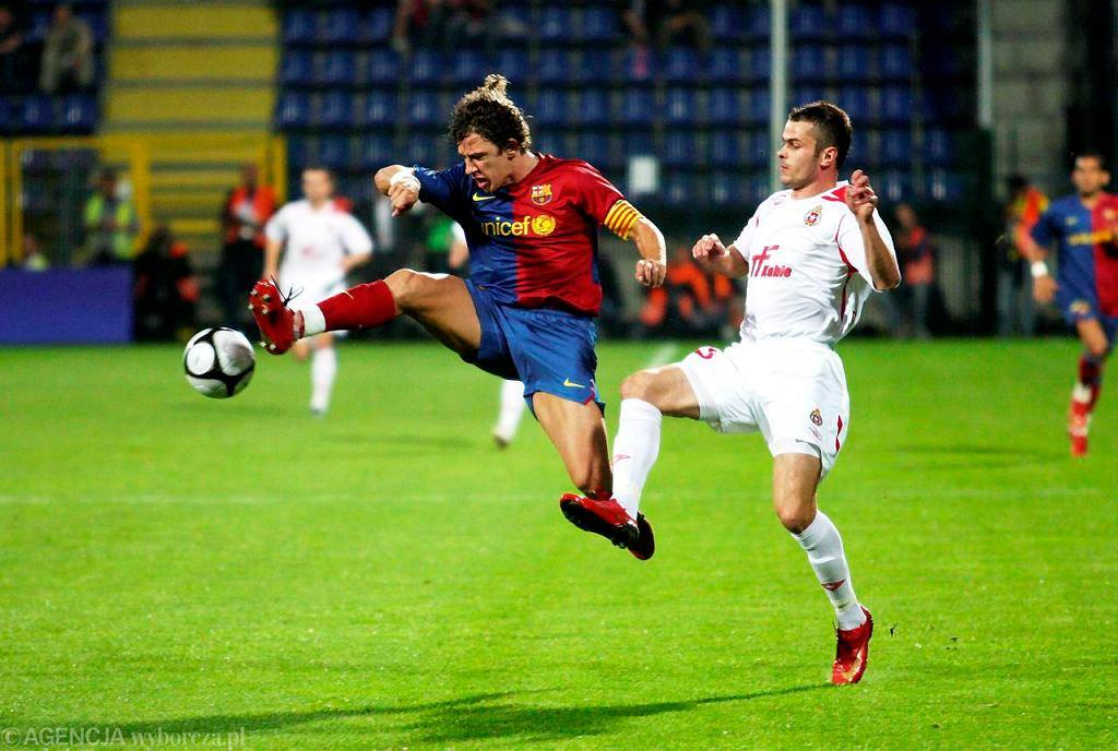 2008 rok: Wisła Kraków - FC Barcelona. Paweł Brożek i Carles Puyol