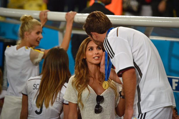 Germany's Mario Goetze greets his girlfriend Ann-Kathrin Broemmel after the World Cup final soccer match between Germany and Argentina at the Maracana Stadium in Rio de Janeiro, Brazil, Sunday, July 13, 2014. Germany won the match 1-0. (AP Photo/Martin Meissner)