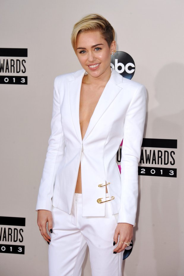 Miley Cyrus arrives at the American Music Awards at the Nokia Theatre L.A. Live on Sunday, Nov. 24, 2013, in Los Angeles. (Photo by Jordan Strauss/Invision/AP)