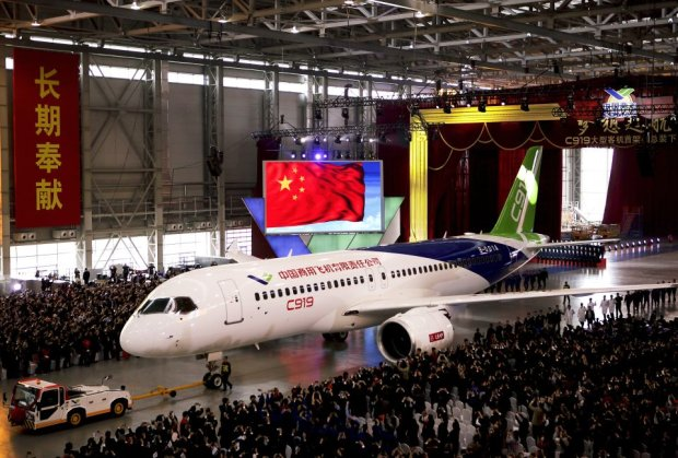 The first twin-engine 158-seater C919 passenger plane made by The Commercial Aircraft Corp. of China (COMAC) is pulled out of the companys hangar during a ceremony near the Pudong International Airport in Shanghai, China, Monday, Nov. 2, 2015. The first plane produced by a Chinese government initiative to compete in the market for large passenger jetliners has been unveiled in Shanghai. (AP Photo)