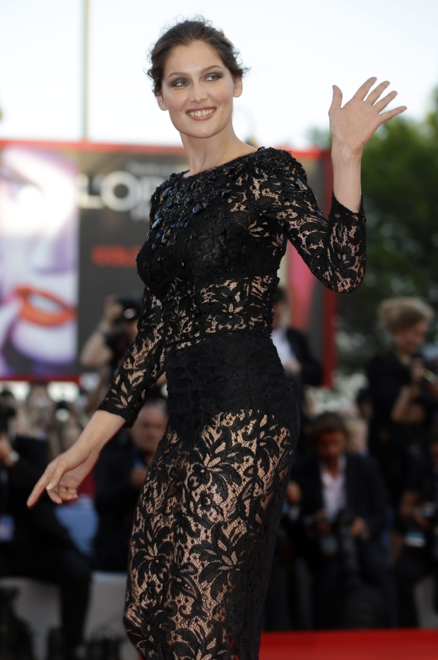 Actress and jury member Laetitia Casta arrives for the premiere of the movie 'The Reluctant Fundamentalist' that opens the 69th edition of the Venice Film Festival in Venice, Italy, Wednesday, Aug. 29, 2012. (AP Photo/Andrew Medichini)
