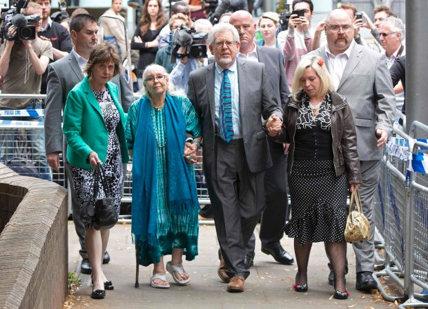 Entertainer Rolf Harris leaves with his niece Jenny, wife Alwen and daughter Bindi (L-R) from Southwark Crown Court in London June 30, 2014. Harris, a mainstay of family entertainment in Britain and Australia for more than 50 years, was found guilty on Monday of 12 charges of indecently assaulting young girls over a period of nearly 20 years.  REUTERS/Neil Hall (BRITAIN - Tags: ENTERTAINMENT CRIME LAW)