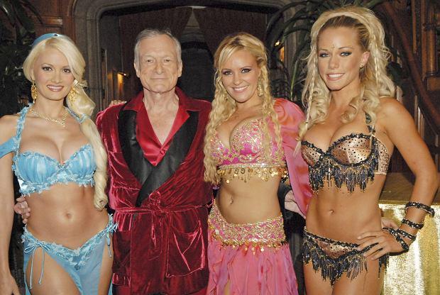 THE GIRLS NEXT DOOR, (from left): Holly Madison, Hugh Hefner, Bridget Marquardt, Kendra Wilkinson, 2005-. ? E! Network / Courtesy: Everett Collection