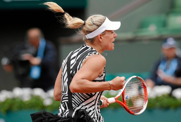 Germany's Angelique Kerber reacts as she plays Netherlands' Kiki Bertens during their first round match of the French Open tennis tournament at the Roland Garros stadium, Tuesday, May 24, 2016 in Paris.  (AP Photo/Michel Euler)