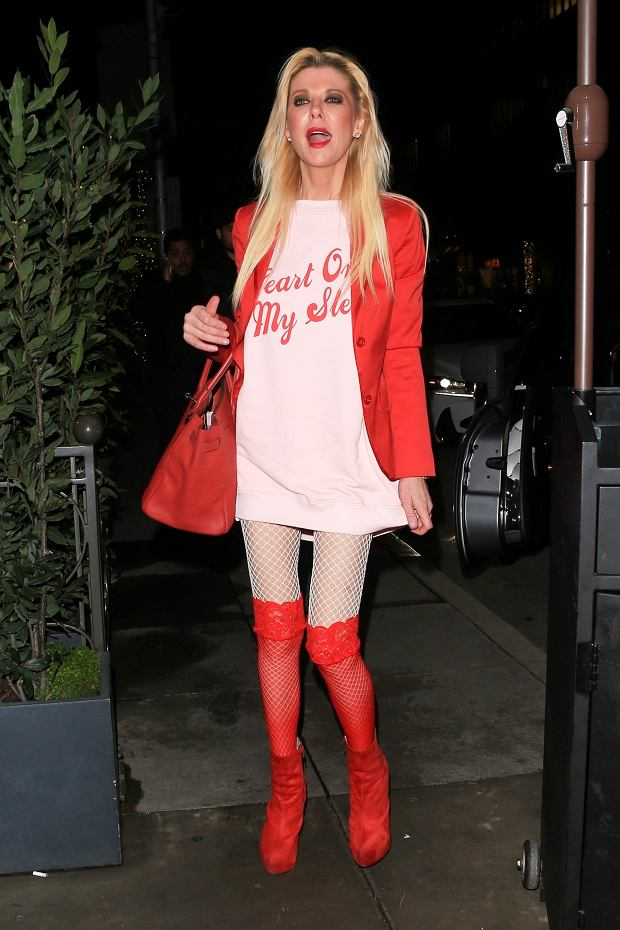 Beverly Hills, CA  - Actress, Tara Reid is in good spirits as she arrives to her Valentine's Day dinner at Madeo dress to the nines in pink. Now that is what I call festive!  Pictured: Tara Reid   BACKGRID USA 14 FEBRUARY 2019   BYLINE MUST READ: GAMR / BACKGRID  USA: +1 310 798 9111 / usasales@backgrid.com  UK: +44 208 344 2007 / uksales@backgrid.com  *UK Clients - Pictures Containing Children Please Pixelate Face Prior To Publication*