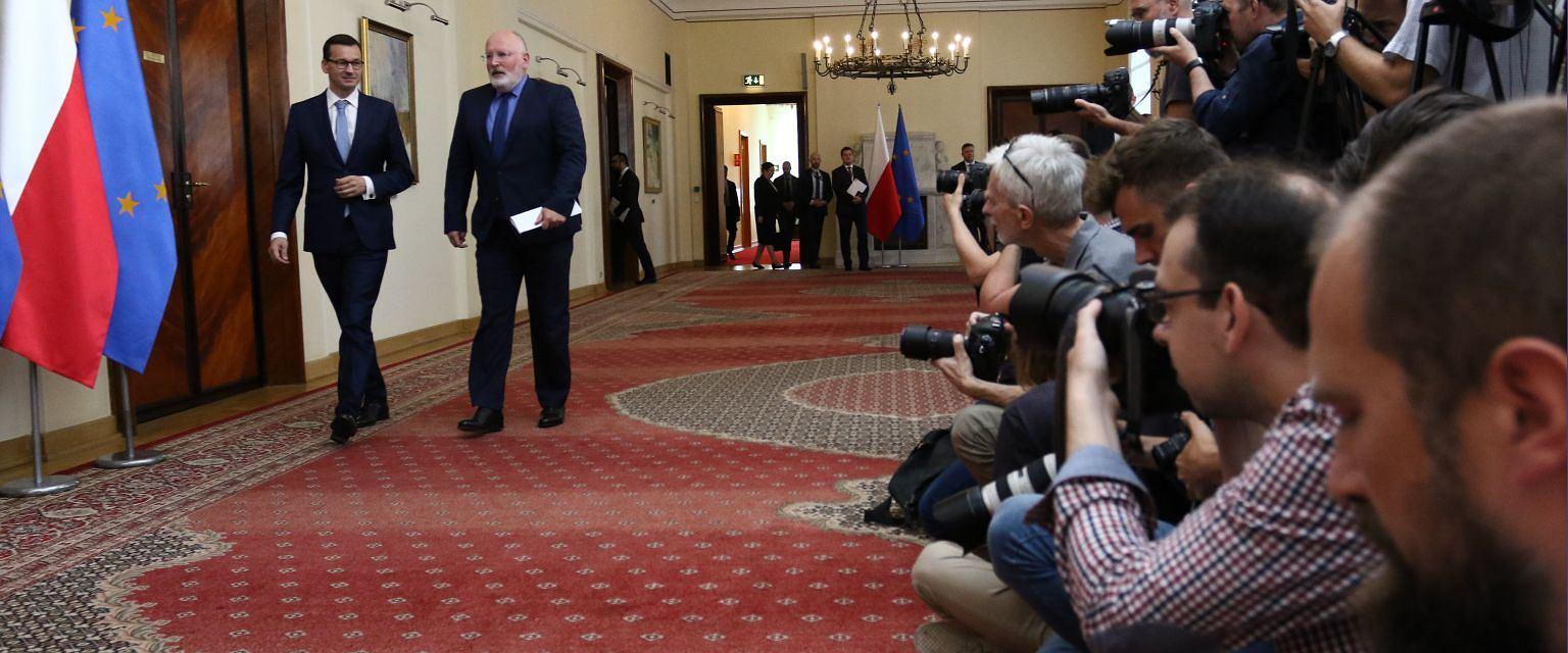 Premier Mateusz Morawiecki i wiceszef KE Frans Timmermans (fot. Sławomir Kamiński/AG)