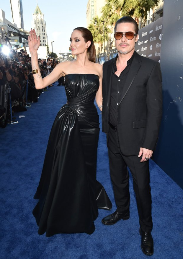 Angelina Jolie, left, and Brad Pitt arrive at the world premiere of