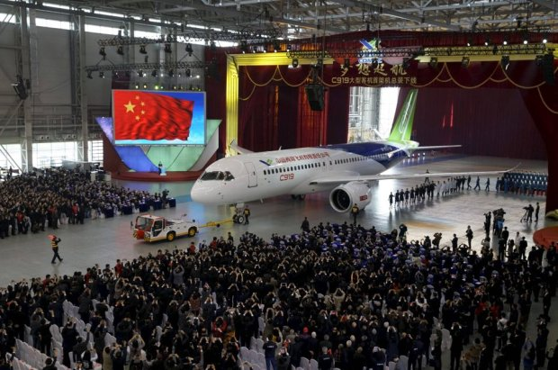 The first C919 passenger jet made by the Commercial Aircraft Corp of China (Comac) is pulled out during a news conference at the companys factory in Shanghai, November 2, 2015. Comac rolled out Chinas first homemade 158-seated C919 narrow body jet, which is meant to rival similar models from Airbus Group and Boeing Co. State television also showed footage of the aircraft rolling off the assembly line in Comacs Shanghai factory. In a statement, the company said it had already received 517 orders for the aircraft mainly from domestic firms. REUTERS/Stringer CHINA OUT. NO COMMERCIAL OR EDITORIAL SALES IN CHINA       TPX IMAGES OF THE DAY