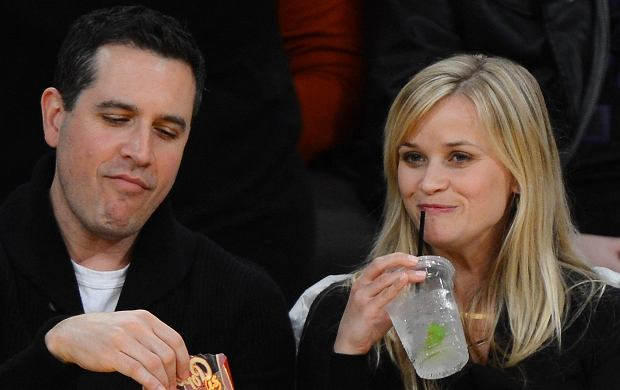 ?2013 GAMEPIKS 310-828-3445 Actress Reese Witherspoon and her husband, CAA agent Jim Toth sit courtside as guests of Jeffrey Katzneberg and his wife Marilyn, as they attend the Los Angeles Lakers vs. Toronto Raptors game at Staples center in Los Angeles on March 8, 2013. The Lakers defeated the Raptors 118-116 in overtime. XYZ