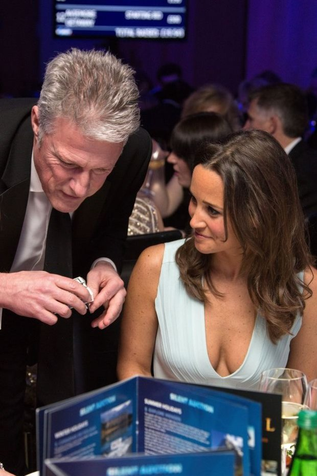 EXCLUSIVE ALL ROUND  Mandatory Credit: Photo by REX (4550309ae)  Pippa Middleton is entertained by magician David Redfearn during the Disability Snowsport UK ParaSnowBall sponsored by Delancey, held at the Cumberland Hotel  ParaSnowBall, London, Britain - 18 Mar 2015