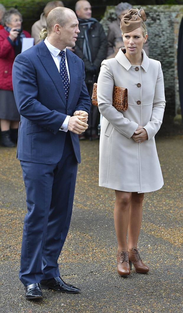 Britain's Zara Phillips (R) and her husband Mike Tindall leave St. Mary's church after attending the annual Christmas service on the Royal Estate at Sandringham in Norfolk, eastern England December 25, 2012. REUTERS/Toby Melville (BRITAIN - Tags: ROYALS SOCIETY)