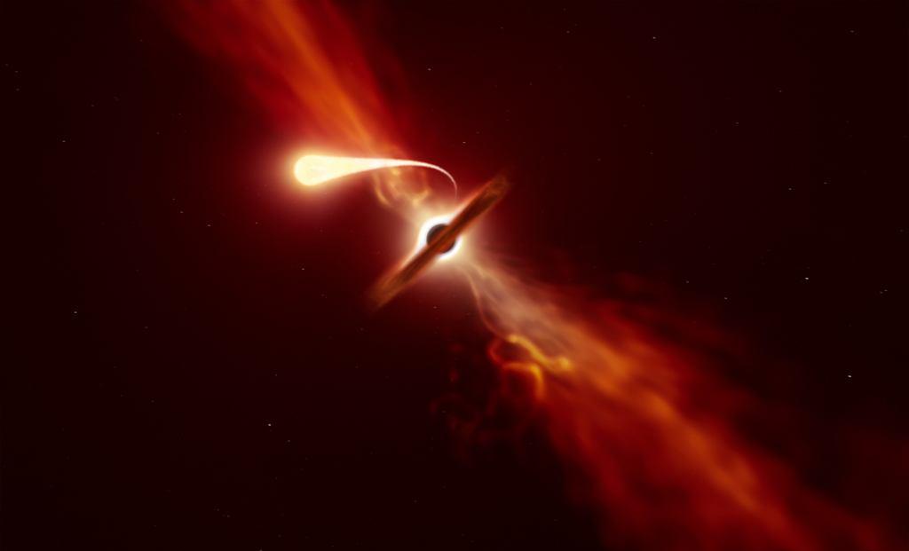 Gwiazda rozrywana przez grawitację czarnej dziury - wizja artysty