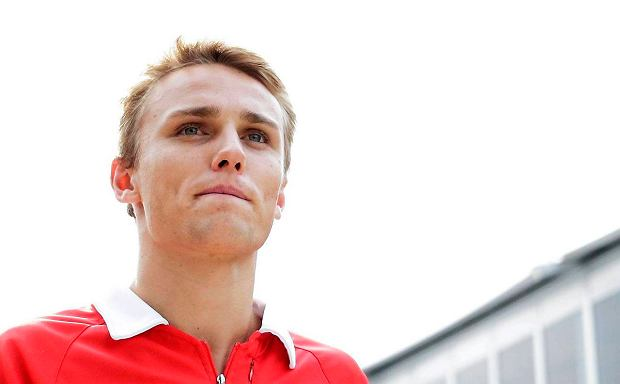 REFILE - CORRECTING YEAR  Marussia Formula One driver Max Chilton of Britain walks in the paddock of the Sepang International Circuit, ahead of the Malaysian F1 Grand Prix March 21, 2013. Chilton is one of five Formula One rookies among the 22 drivers on the grid this season and while the Briton is still learning the art of being lapped he is confident he can make an impact. Chilton was promoted from Marussia's GP2 team after coming fourth in that series last year and despite finishing a lowly 17th at the season-opener in Australia, the 21-year-old believes he is at the start of a long journey at the sport's elite level. REUTERS/Tim Chong (MALAYSIA  - Tags: SPORT MOTORSPORT F1) SLOWA KLUCZOWE: :rel:d:bm:SR1E93L0RH75V